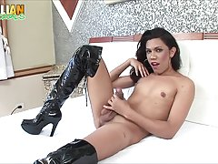 Debora Mendes is a pretty brunette with a nice body and a sexy ass! Watch this cutie posing and stroking her cock hard!