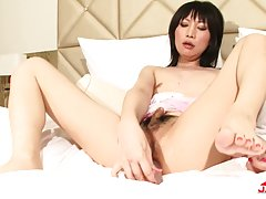 Hot transgirl Hinata Kanan has a great time in her pink lingerie on the bed as she fucks her ass with her dildo. She has a nice body, natural tits and a rock hard tgirl cock.