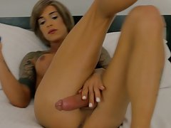 Smoking hot Nina Lawless has a sexy slim and well toned body, big tats and perky tits, a firm bubble butt and a sexy hard cock! Watch this horny tgirl jacking off for you!