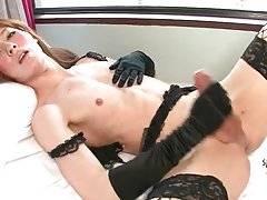Naughty Asian she-male Lisa pleasures herself on camera.
