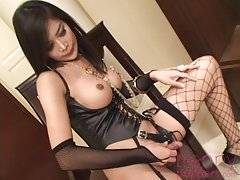Gorgeous young shemale starlet Om is unbelievably sexy in her black lace lingerie, licking her pouty lips and smiling seductively