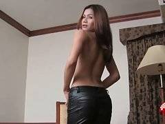 Naughty ladyboy warms herself up by teasing her tits.
