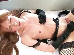 Naughty Asian she-male Lisa pleasures herself on camera.
