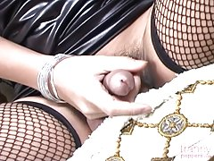 May returns for her close up in this smokin` hot solo video that puts the Asian tranny to the test with a jerk-off session. Wearing a striking, tight outfit and fishnet stockings, seeing her big dick hang between those long legs is going to have you going