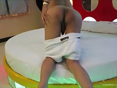 Chompoo takes off her white bootyshort outfit in a love motel to stroke. Chompoo has nice tits and wet stick. She lays back on the bed and rubs with her butthole. Chompoo jerks off and cums, then tastes her sticky Ladyboy juices.