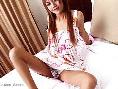 Gorgeous and innocent ladyboy Sandy from the exotic islands of Phuket, dressed in cute denim shorts features in this all exclusive LadyboyGold episode.