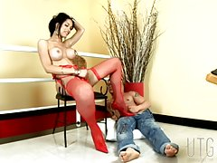 Looking immaculate in her red stockings and lingerie, Isabelle has a massive grin from ear-to-ear throughout her encounter with buff and tattooed Silvio, who looks equally in ecstasy when he`s fucking that Tgirl hole with his cock after the raven-haired b